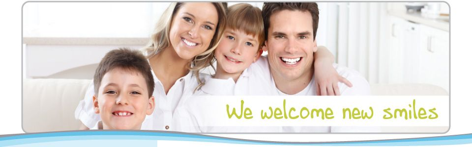smiling family with two young boys | We welcome new smiles - dentist Kamloops